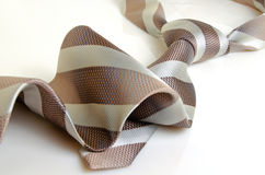 His tie in diagonal stripes. Stock Images