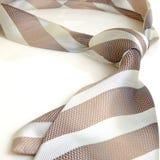 His tie in diagonal stripes. Royalty Free Stock Photo