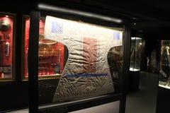 Hisart världar först och endast bosatt historiemuseumDiorama, talismanic skjortor Arkivbilder