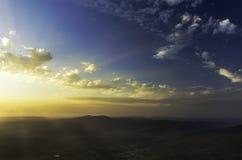 Hisnande solnedgång Arkivbild