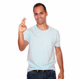 Hispanic adult man crossing his fingers Stock Photography