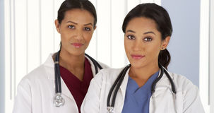 Hispanic and African American female doctors in hospital Royalty Free Stock Photos