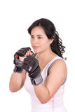 Hispanic aggressive woman with boxing gloves Stock Photo