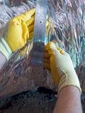 Maintenance man. Hispanic airconditioning repair man performing maintenance Stock Image