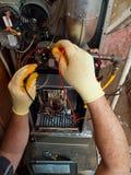 Repair man. Hispanic airconditioning repair man performing maintenance Stock Images