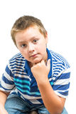 Hispanic-American Child Rests Chin On Hand During Picture. Hispanic-American Child Rests Chin On Hand Stock Photography