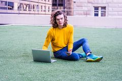 Young Hispanic American College Student Studying in New York. Hispanic American College Student studying in New York, wearing glasses, yellow long sleeve T shirt Royalty Free Stock Photography