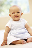 Hispanic baby girl at home Stock Photos