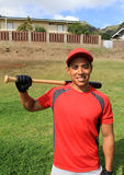 Hispanic baseball player in the field smiling Stock Images