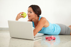 Hispanic beautiful woman surfing the web Stock Photography