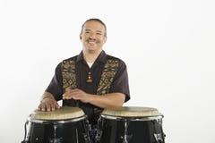 Hispanic Bongo Drum Player Stock Photography