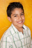 Hispanic Boy. Handsome young Hispanic in front of yellow wall Royalty Free Stock Photos