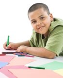 Hispanic boy coloring. Royalty Free Stock Photos