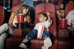 Hispanic boy excited about a movie Stock Photo