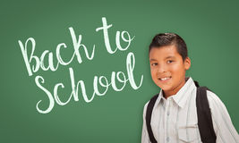 Hispanic Boy In Front of Back To School Chalk Board Royalty Free Stock Image