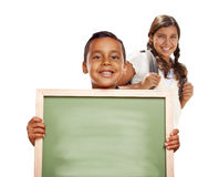 Hispanic Boy and Girl Holding Blank Chalk Board on White Royalty Free Stock Photography