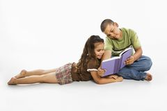 Hispanic boy and girl reading book together. royalty free stock image
