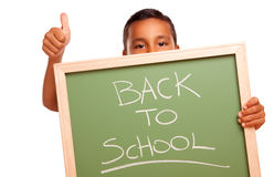 Hispanic Boy Holding Back to School Chalkboard. Cute Hispanic Boy Holding Chalkboard with Back to School Isolated on a White Background Stock Images