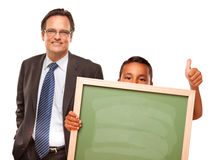 Hispanic Boy Holding Blank Chalk Board with Man Stock Photo