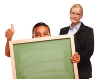 Hispanic Boy Holding Blank Chalk Board and Teacher Royalty Free Stock Photo