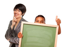 Hispanic Boy Holding Blank Chalk Board and Teacher Stock Image