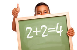 Hispanic Boy Holding Chalkboard with Equation Stock Photos