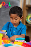 Hispanic Boy in Home School Setting Stock Photo