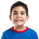 Hispanic boy missing a teeth. Portrait of a small hispanic boy missing a teeth isolated on white Royalty Free Stock Photo