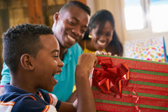 Hispanic Boy Opening Gift Box Happy Black Child Celebrating Birt Stock Image