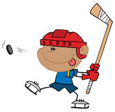 Hispanic boy playing hockey Stock Photos