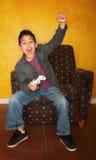 Hispanic Boy Playing Video Game Royalty Free Stock Images
