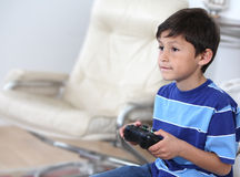 Hispanic Boy playing video game Stock Photos