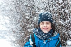 Hispanic Boy Portrait in a Snowy Day Royalty Free Stock Photos