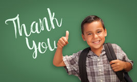 Hispanic Boy with Thumbs Up in Front of Chalk Board with Thank Y