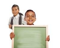 Hispanic Boys Holding Blank Chalk Board on White Background Stock Photography