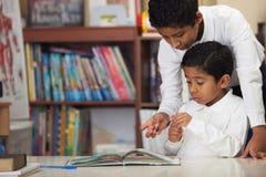 Hispanic Boys in Home-school Studying Rocks Stock Photo
