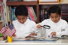Hispanic Boys in Home-school Studying Rocks Stock Image