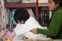 Hispanic Boys Hugging After Home Worship Service. In Classroom stock images