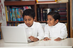 Hispanic Boys with Laptop. In Home-School Setting Royalty Free Stock Photography