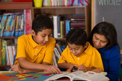 Hispanic Boys with Mom in Home-School Environment Royalty Free Stock Photos
