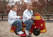 Hispanic boys at playground stock images