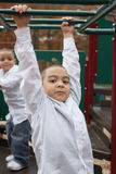 Hispanic boys at playground Stock Photos