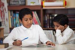 Hispanic Boys Studying Rocks Royalty Free Stock Image