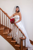 Hispanic Bride Walking down Stairs Royalty Free Stock Images