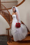 Hispanic Bride Walking down Stairs Stock Image