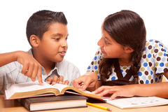 Hispanic Brother and Sister Having Fun Studying Royalty Free Stock Image