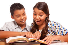 Hispanic Brother and Sister Having Fun Studying Stock Photo