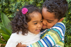 Hispanic brother and sister. Hispanic brother and sister laughing and hugging Stock Photos