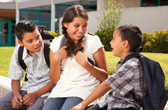 Hispanic Brothers and Sister Talking Ready for School. Cute Hispanic Brothers and Sister Talking Ready for School on Morning Royalty Free Stock Photo