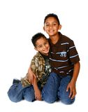 Hispanic Brothers Smiling and Hugging Royalty Free Stock Photo